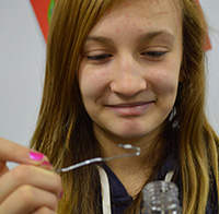 Alissa Minaker looks at the DNA she extracted from wheat germ
