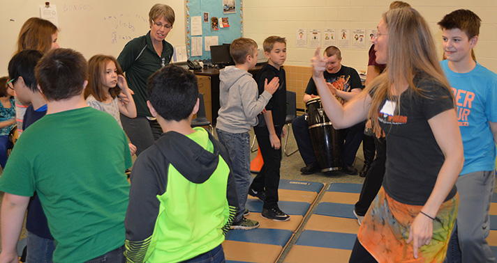 CI students and their LINKS friends join teachers and music instructors in a dance circle