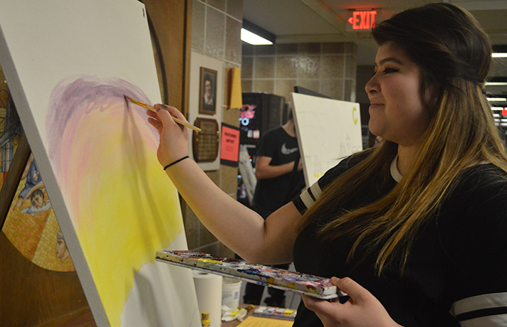 Godwin Heights High School Senior Yaneli Fragosa works on an acrylic painting