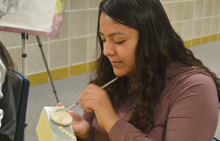 Senior Valerie Zamora paints a clay jewelry box she created