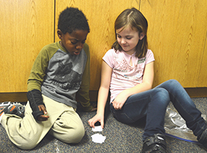 Isaiah Wiseman and Alivia Walber work together on remembering numbers
