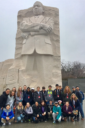 Wyoming High School students stand in front of the Martin Luther King, Jr. Memorial