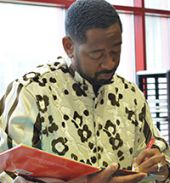 "Author and educator Byron Garrett signs his children's book, ""There's Greatness on the Inside,"" following his presentation"