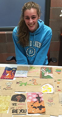 Senior Kelly Keen led the effort to have students decorate supper sacks for Kids' Food basket