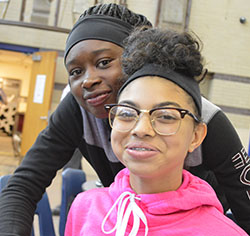 Cydney Hansma and her friend, Marquaisa Welch, eat lunch at Kelloggsville Middle School