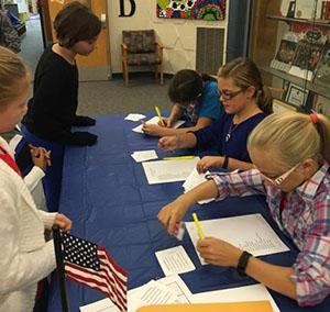 Fifth-graders register voters for a schoolwide election