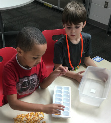 Liam Kaeppner and Isaiah Bishop separate kernels