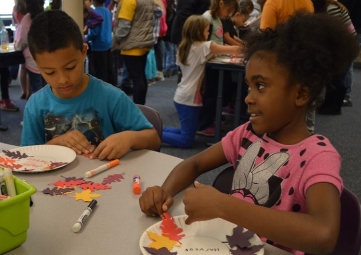 Third-graders Omariyah Wilson-Smith and Kendrick Mayhue make decorations