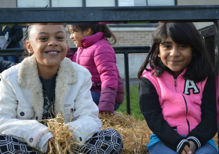 Third-graders Nialeah Sparks and Aliyah Santiago are ready for the hayride