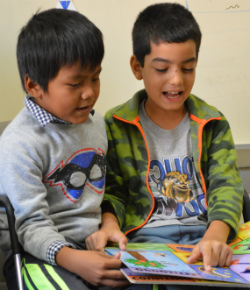 Second-graders Ranish Dhakal and Abinash Tamang read together