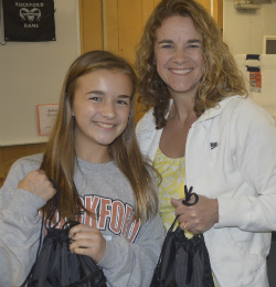 Seventh-grader Lauren Massa and her mother, Kelly, help out with other volunteers from Rockford United Methodist Church