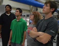 East Kentwood students watch production during a tour of automotive components manufacturer Swoboda
