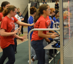 Girls compete, commanding their robots to move