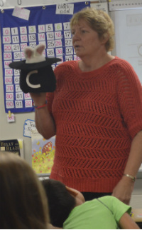 """Teacher Mary Lou Ohnsman gets help from the """"Magic C Bunny"""" in teaching her third-graders handwriting"""