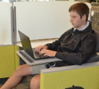 "Junior Nate Spitzley in what learning commons coordinator Cathy Szivan calls a ""Jetson seat"""