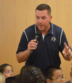 "Principal Steve Minard counts down with kindergartners before shouting, ""West Godwin rocks!"""