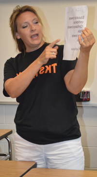 Teacher Molly Stabler shows students a Confucius quote