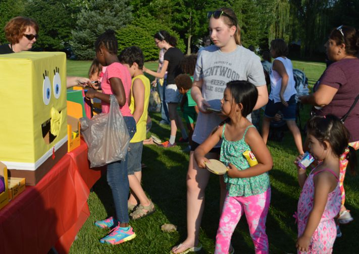 Students play carnival games for school supplies