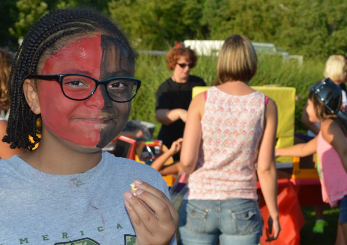 Kentwood Public Schools sixth-grader Olivia Openshaw celebrates in school colors