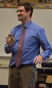 54th Street Academy teacher Rick Jackson plays an icebreaking game during an iTeach meeting