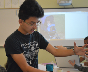 Sophomore James Tran brainstorms cat stroller designs during the 5-Minute Design Challenge