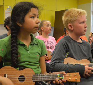 Kelloggsville students learn songs using just four chords