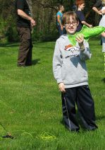 Fourth-grader Koen Unangst practices fly fishing with help from Schrems West Michigan Trout Unlimited