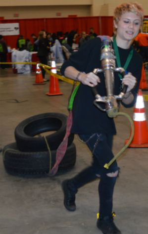 A City High School student takes a first responder challenge to drag a tire through an obstacle course