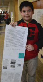 Fourth-grader Abel Garcia shows his writing