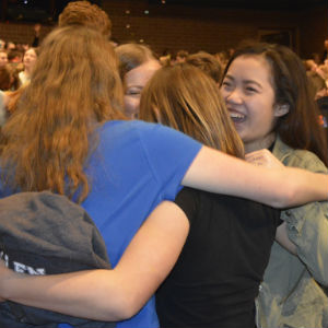 Freshman Lecia Strunk, right, celebrates the surprise announcement with friends from the marching band
