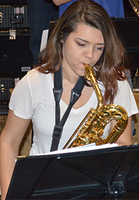 Junior Lauren Elliott plays the baritone saxophone