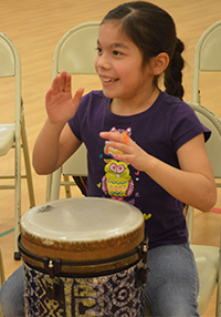Isabel Deleon-Magana smiles as she plays