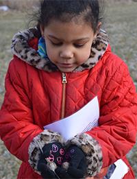 Peyton Hudson shows plants she found outside