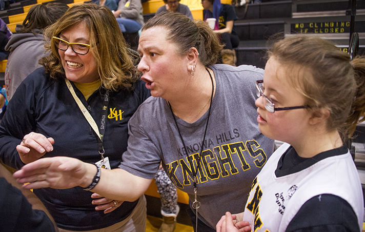Carie Wojtas, the Knights' coach, gives a play with Melissa Stubbs (left) and Ally  Schoenborn (right) looking on