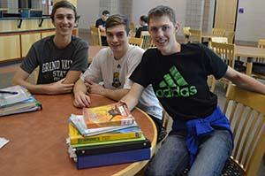 Alex Royce and Ben Pattison, friends of Connor Zondervan, right, have seen him become much more confident at Caledonia High School