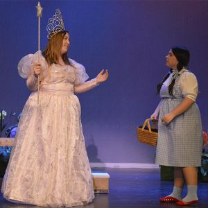 Dorothy, played by Aubrianna Ensley, meets Glinda the Good Witch of the North, played by Abi Garza, in the Cedar Springs High School production