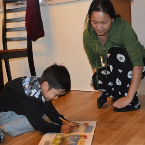 Mother Nzun Chin watches John, 4, trace