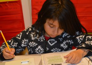 Jennifer Ramirez works on her reading