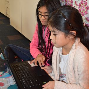 Endeavor Elementary fifth-graders Christine Tran and Amberly Nguyen practice coding