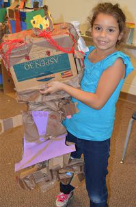 Second-grader Arianna Escribano holds her robot