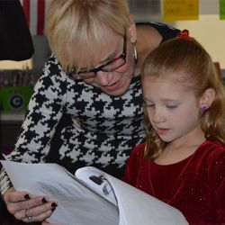 Principal Barb Johnson looks at a Brown Elementary School students story
