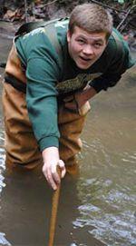 Comstock Park High School student John Zalinski gets a little wet
