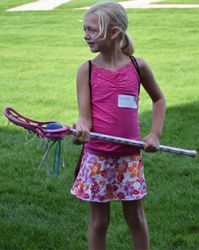 A Grandville elementary student tries lacrosse during the 2014 Girls Sports Day event