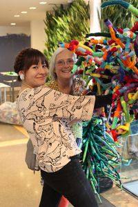 """Pam Jasperse, art teacher at Forest Hills MeadowBrook Elementary and her student teacher, Naomi Poel from Kendall College of Art and Design, pose near """"Connectivities"""""""
