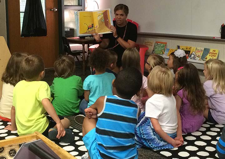 Kindergarten teacher Amy Bianchi settles students in for part of the daily routine: story time (photo by Shaunna Ager)