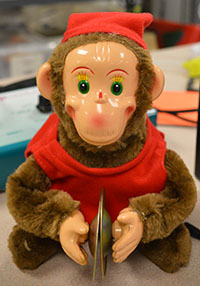 Toys like this push-button monkey help students learn cause-and-effect