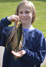 Fourth-grader Tara Rood shows off her large-mouth bass