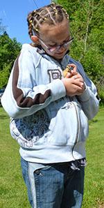 Fourth-grader Jakquelynne Ridout pets a duckling