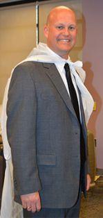 Principal Craig Hoekstra wears a plastic-bag cape