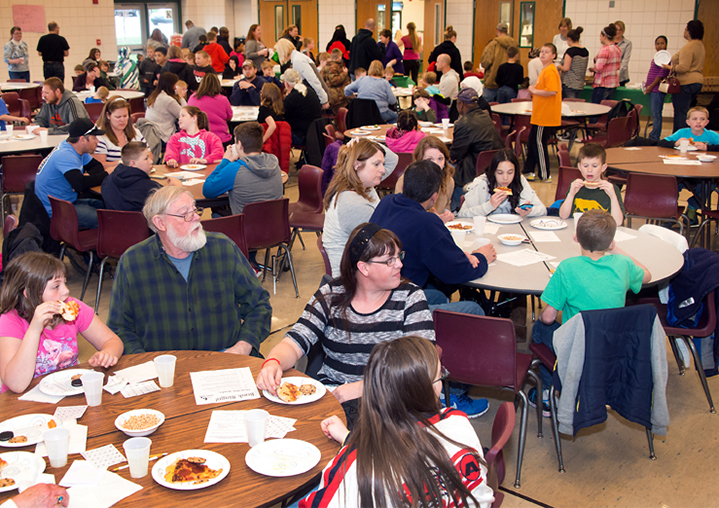 Families noshed on pizza and marked their bingo boards with cheerios